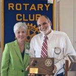 Incoming President Dianne Snyder awards the Past President plaque to Coleman Keeter.